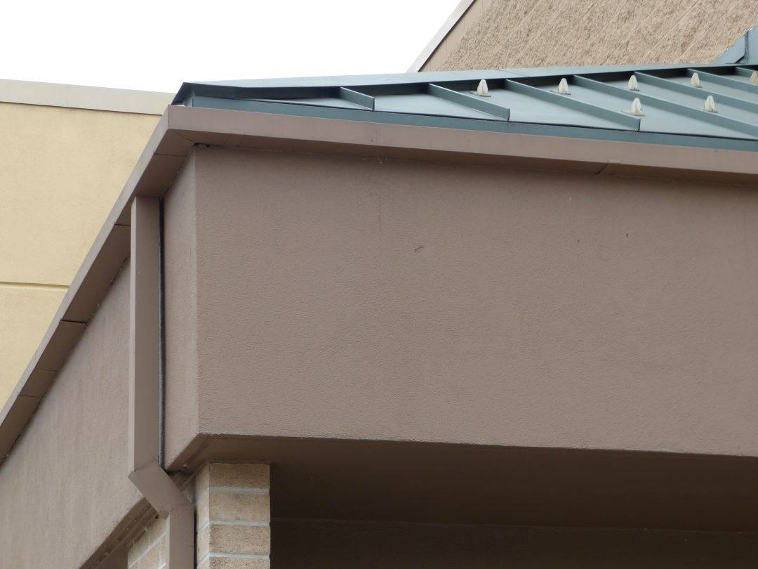 a commercial roof with gutters