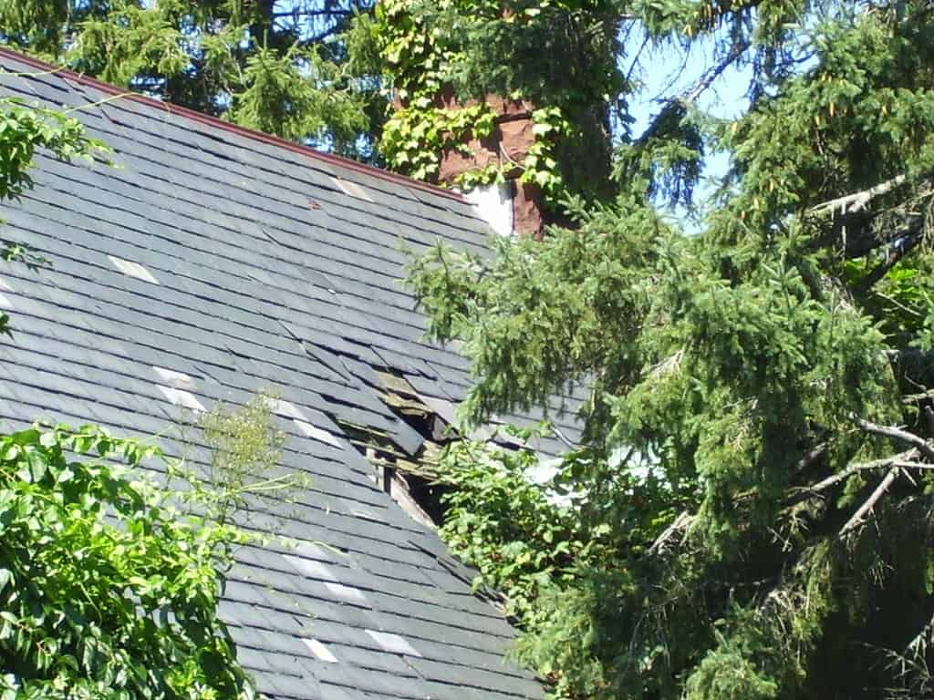 a badly damaged roof in need of emergency roofing repairs