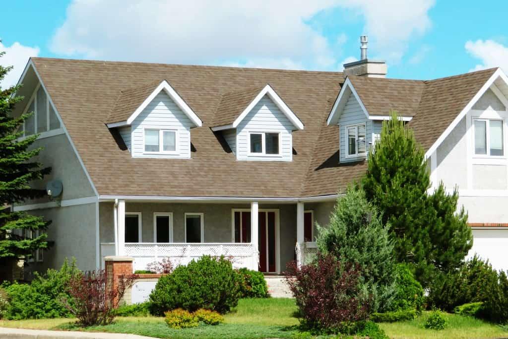 a suburban home with an asphalt shingle roof