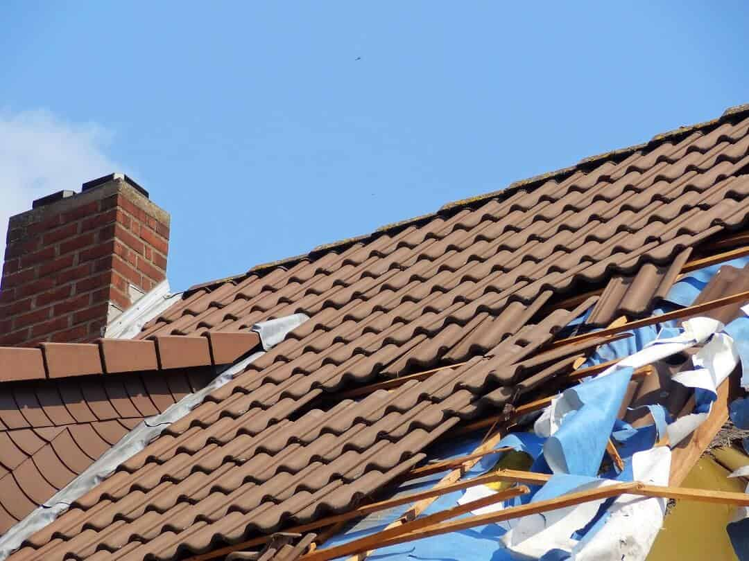 a tile roof undergoing repairs
