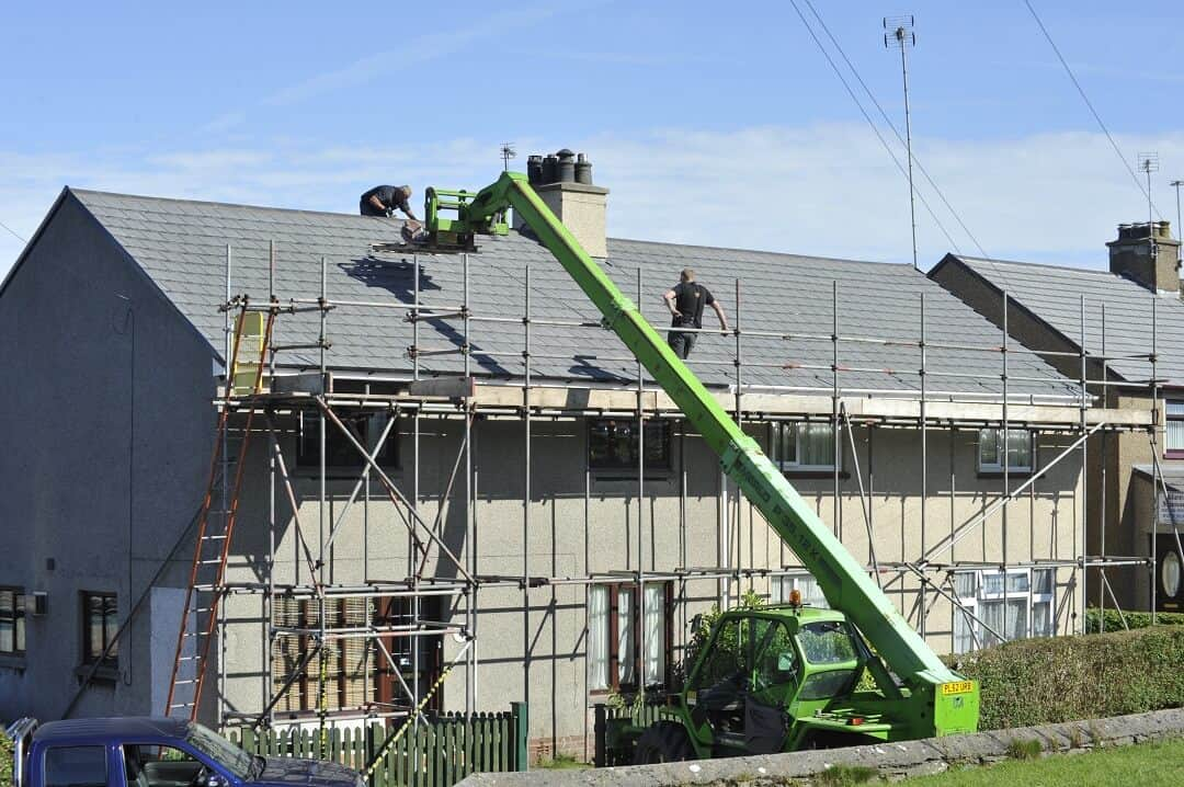 a roofing company works to repair a roof